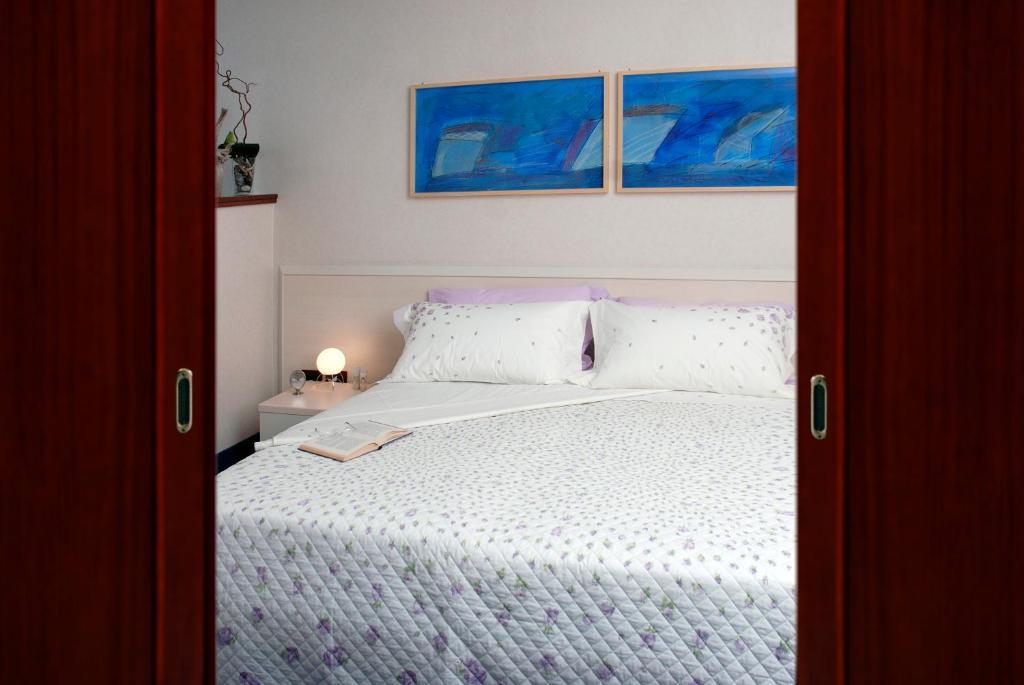 Letto o letti in una camera di Residence Cristoforo Colombo