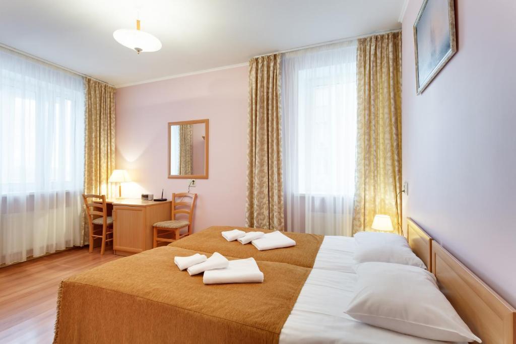 Кровать или кровати в номере Апарт-отель Диадема