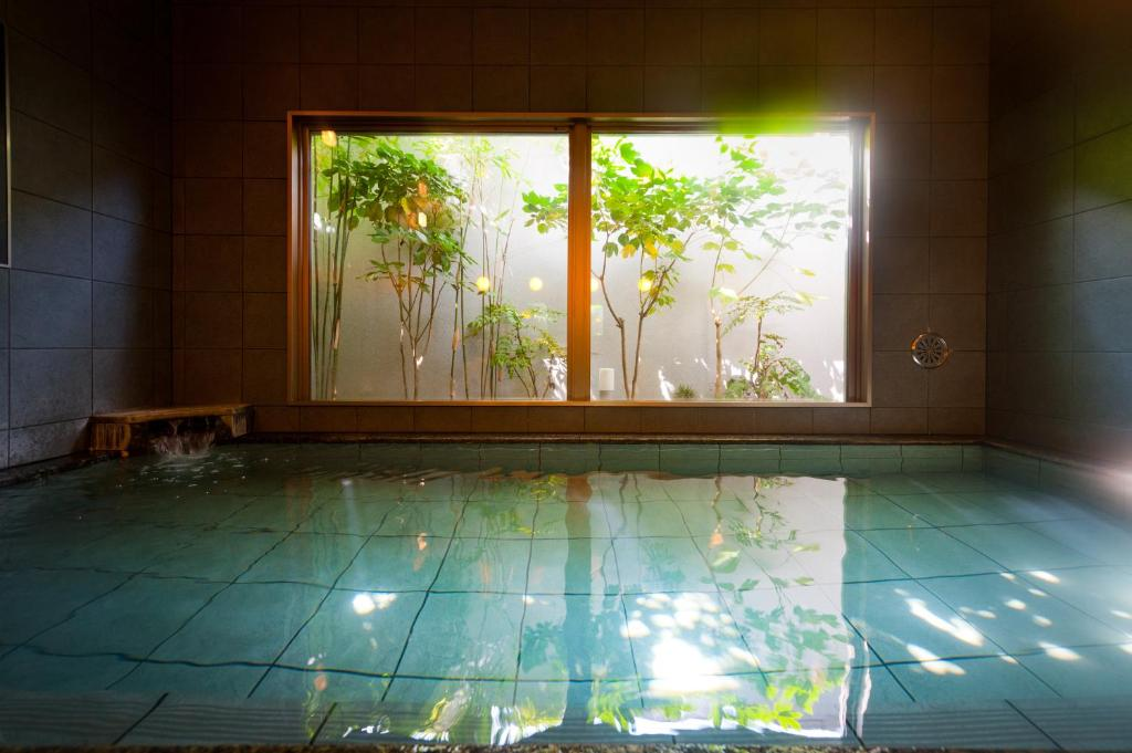 The swimming pool at or near Super Hotel Arai Niigata