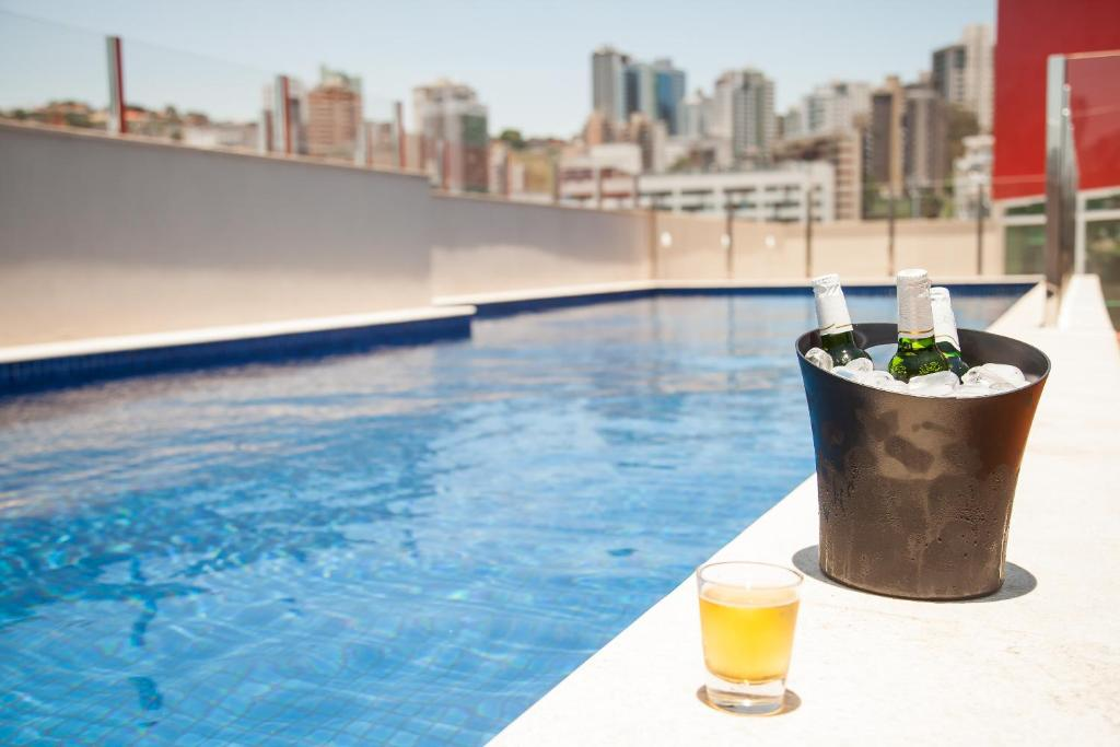 The swimming pool at or near Ramada Encore by Wyndham Belo Horizonte Virginia Luxemburgo