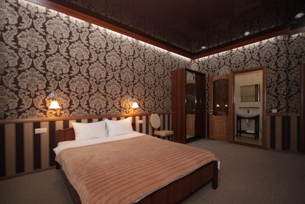Кровать или кровати в номере Carlson Hotel Zheleznogorsк