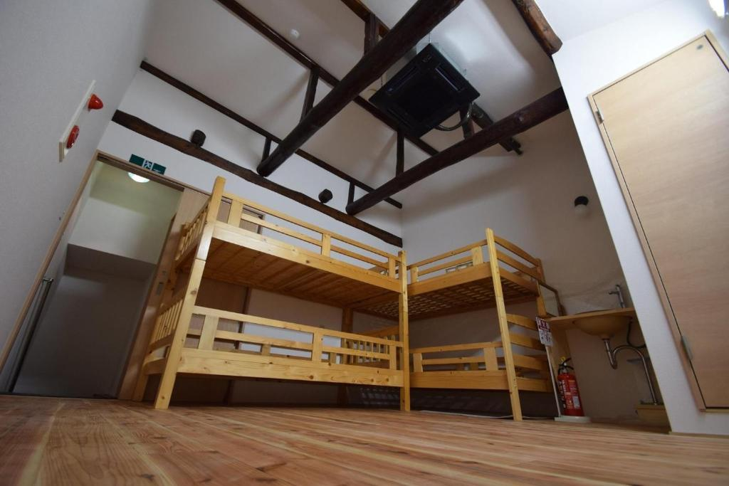 A bunk bed or bunk beds in a room at Santana Guest House Kyoto