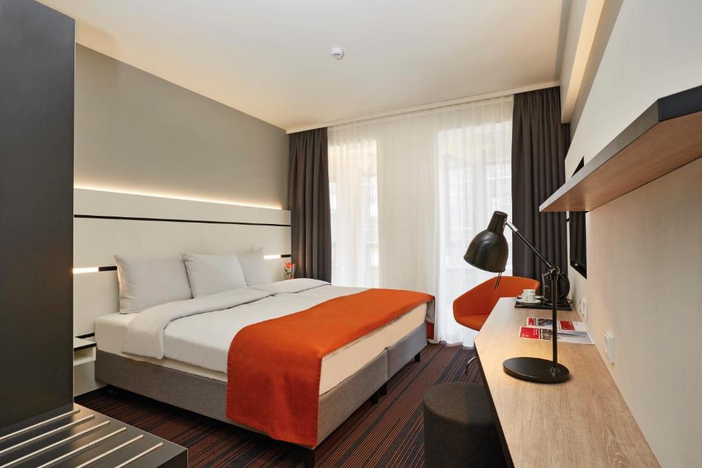 Ein Bett oder Betten in einem Zimmer der Unterkunft Hyperion Hotel Hamburg
