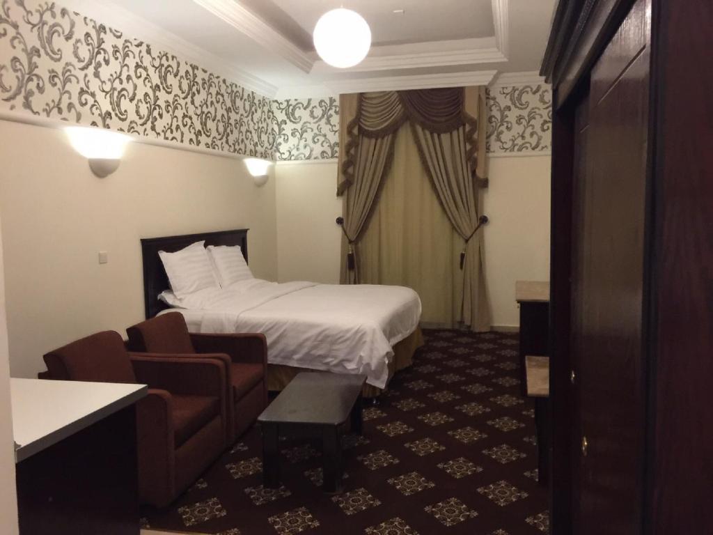 Cama ou camas em um quarto em Al Denny Aparthotel
