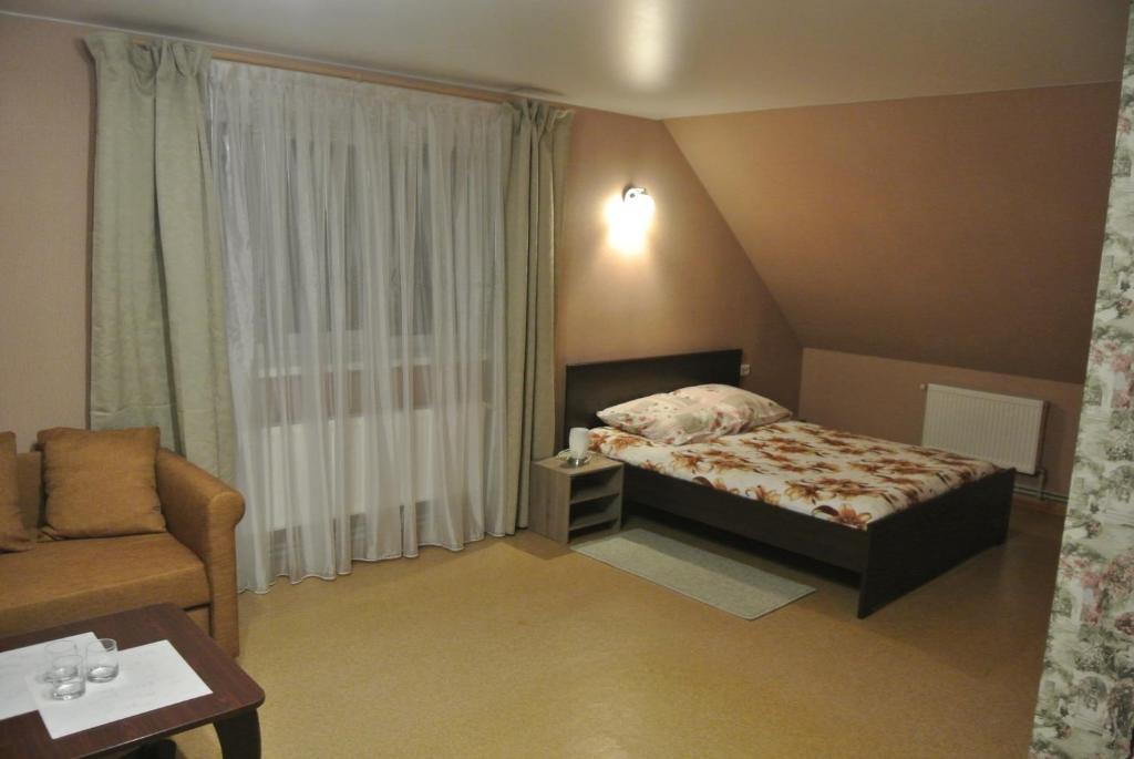 Кровать или кровати в номере Inn Na Suzdalskoy