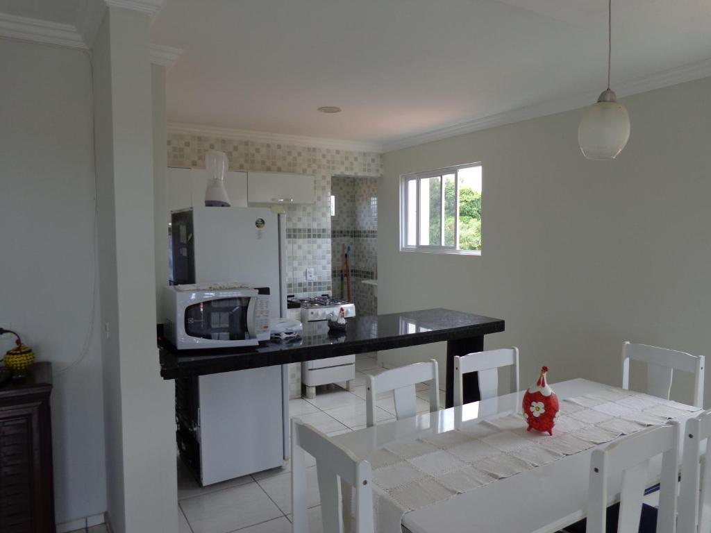 A cozinha ou cozinha compacta de Apartamentos Rua Saberé