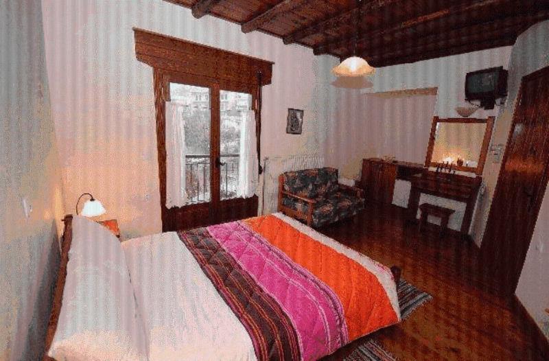 Ένα ή περισσότερα κρεβάτια σε δωμάτιο στο Μορφέας