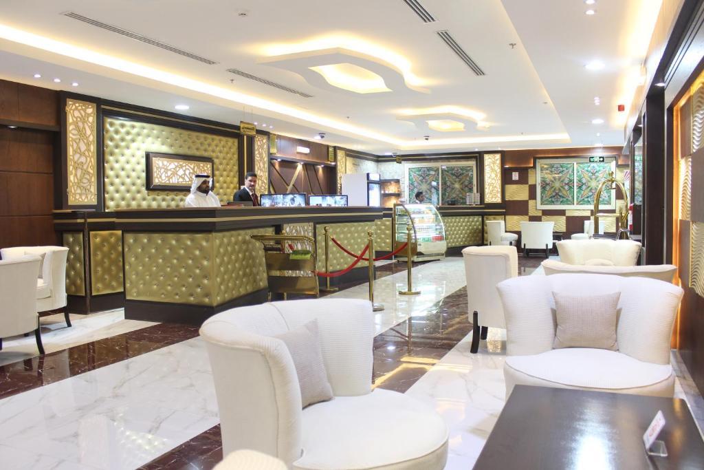 O lounge ou bar de Noor Amal Hotel Apartments As Sulay