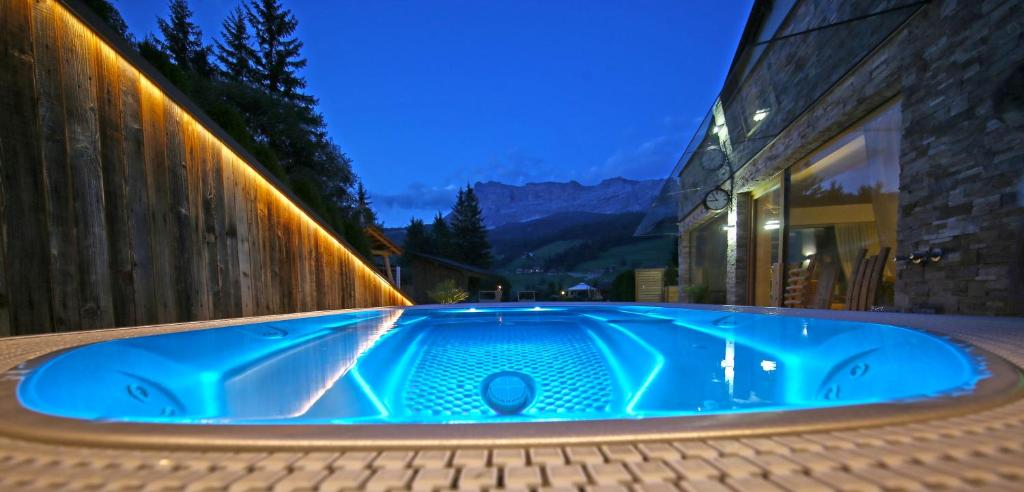 The swimming pool at or near La Bercia Dolomites Chalet