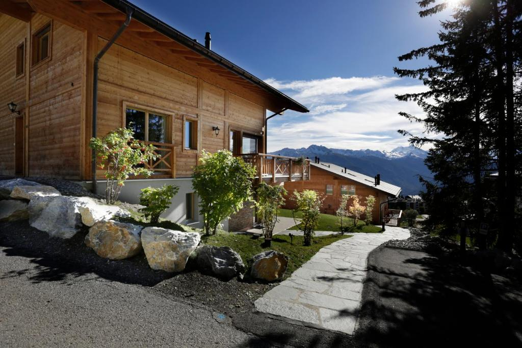 A porch or other outdoor area at Crans Luxury Lodges