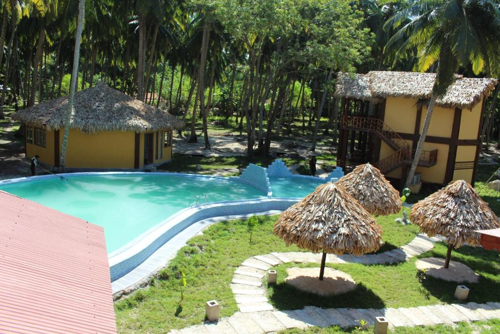 The swimming pool at or near Silver Sand Beach Resort Neil
