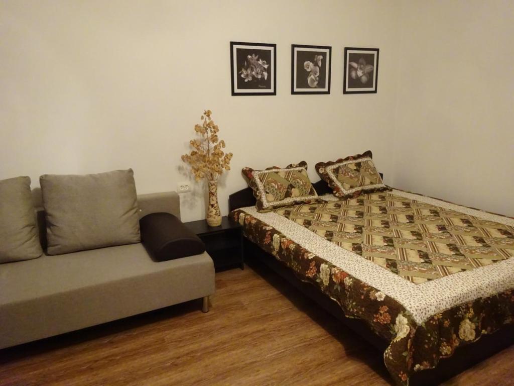 Кровать или кровати в номере Гостевой дом УЮТ