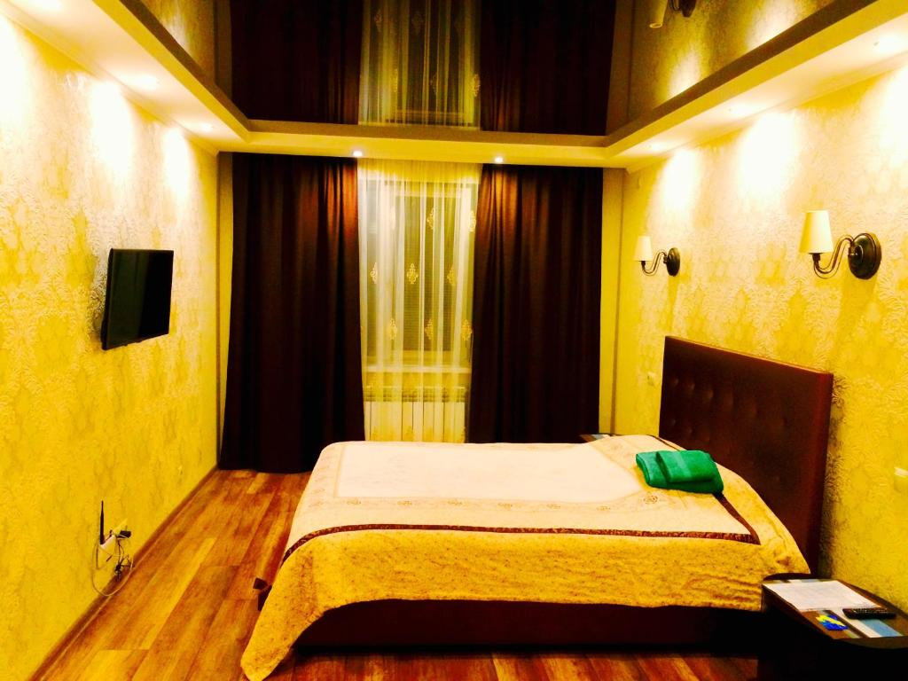A bed or beds in a room at VIP apartment