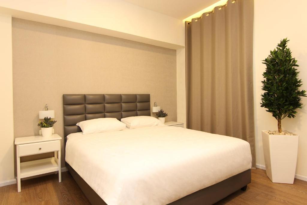 מיטה או מיטות בחדר ב-מלון אידלסון