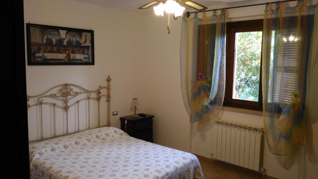 Кровать или кровати в номере Villa San Nicola B&B