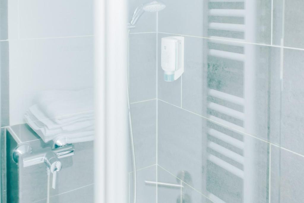 Ein Badezimmer in der Unterkunft Fair Hotel Mönchengladbach City