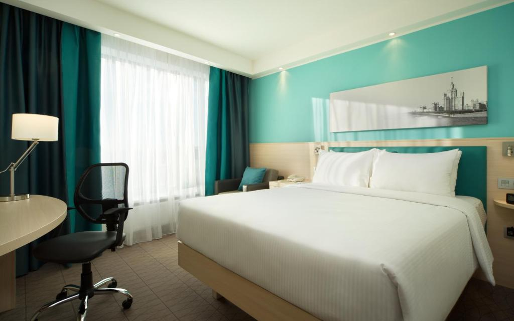 A bed or beds in a room at Hampton by Hilton Moscow Strogino