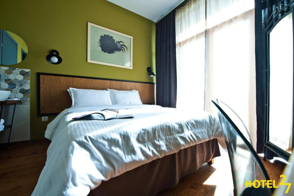 A bed or beds in a room at Boutique Hotel 27