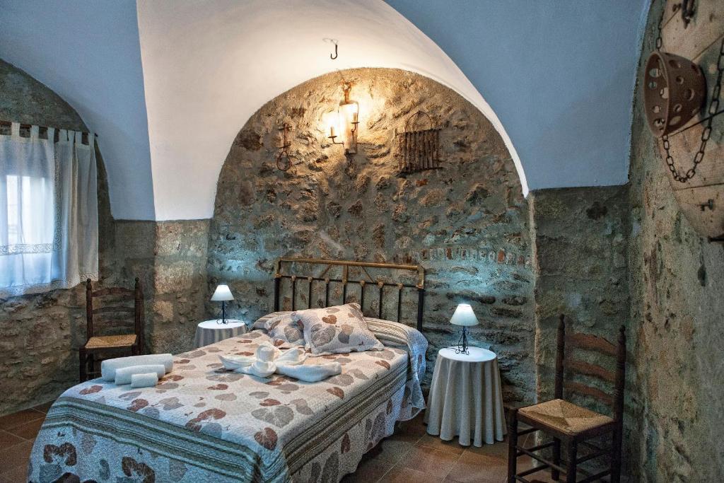 Кровать или кровати в номере Apartamentos Rurales La Casa de Luis