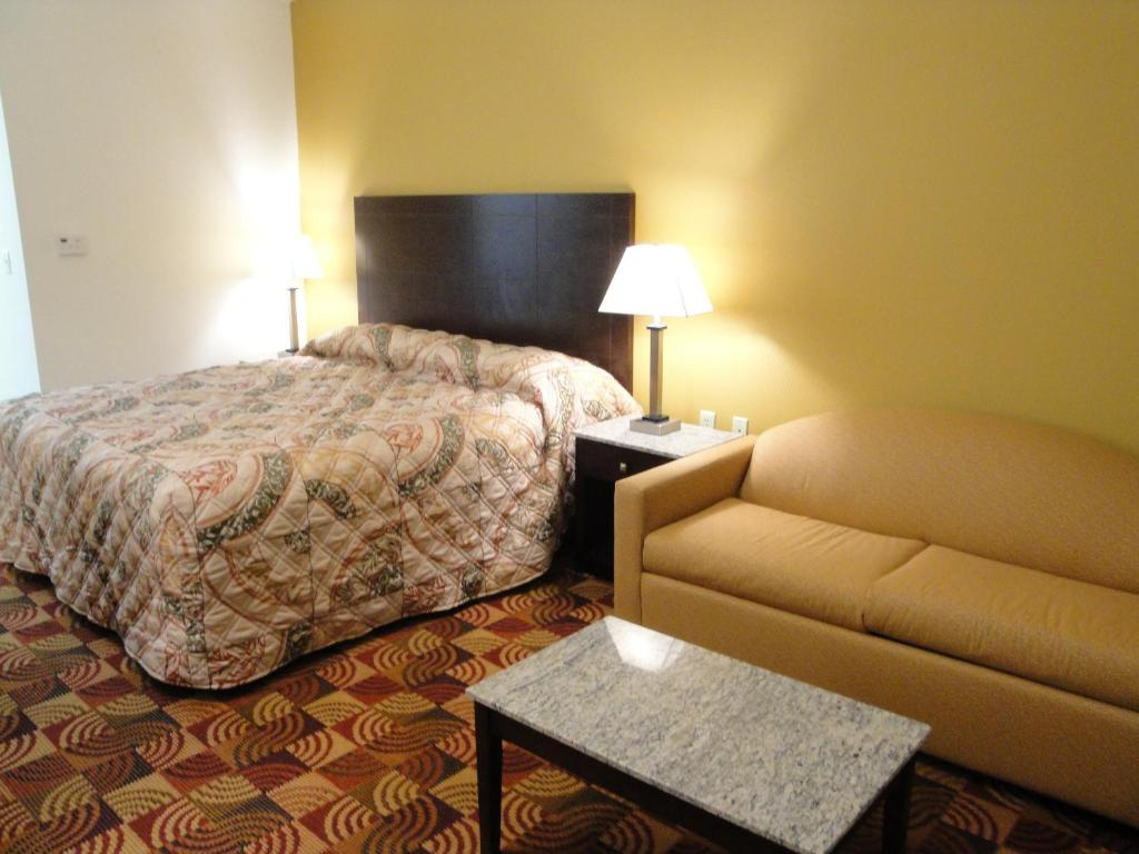 A bed or beds in a room at Sands Inn & Suites