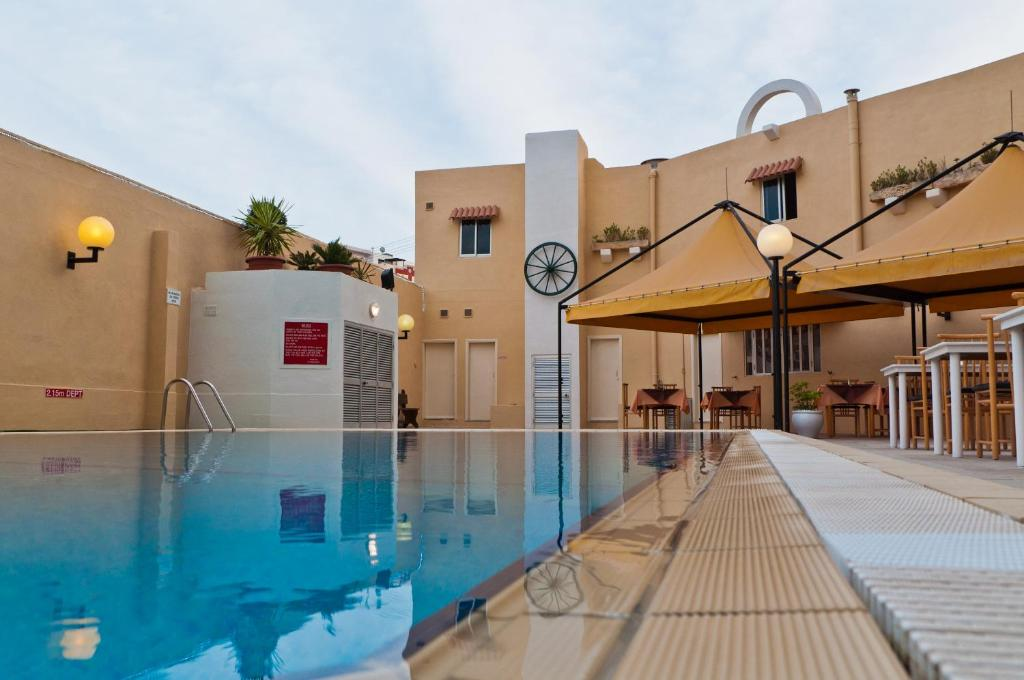 The swimming pool at or near Mavina Hotel & Apartments