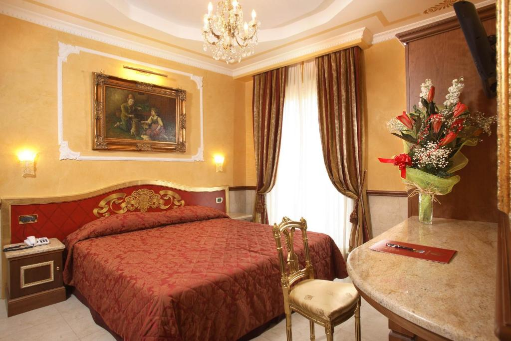 A bed or beds in a room at Clarion Collection Hotel Principessa Isabella