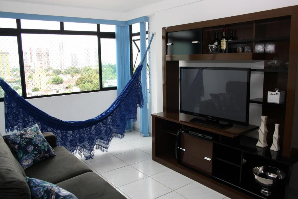 A television and/or entertainment center at Apartamento Green Park