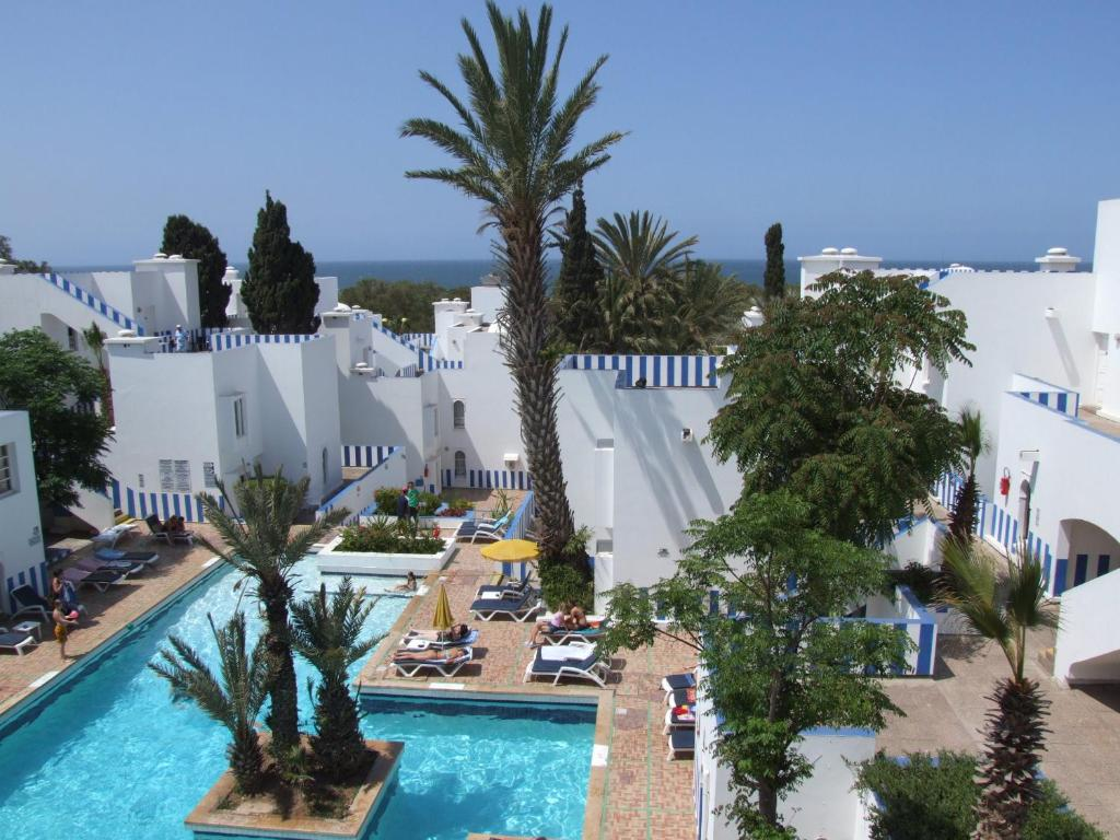 A view of the pool at Appart-Hôtel Tagadirt or nearby
