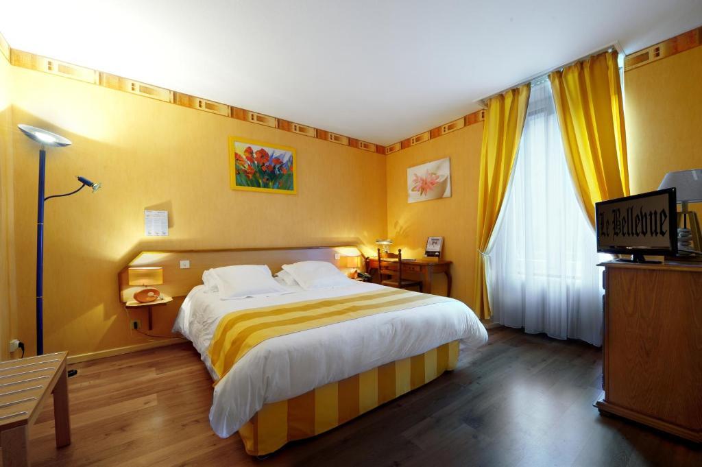 Un ou plusieurs lits dans un hébergement de l'établissement Hotel Le Bellevue