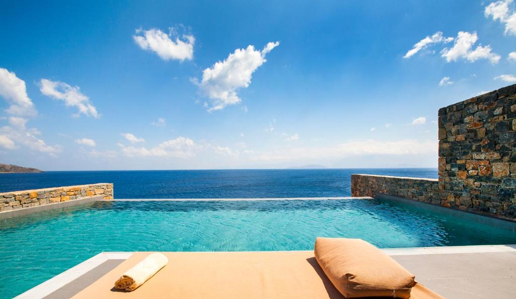 The swimming pool at or near Tui Blue Elounda Village Resort & Spa by Aquila