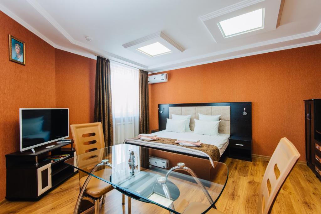Кровать или кровати в номере Fedorov ApartHotel Barnaul