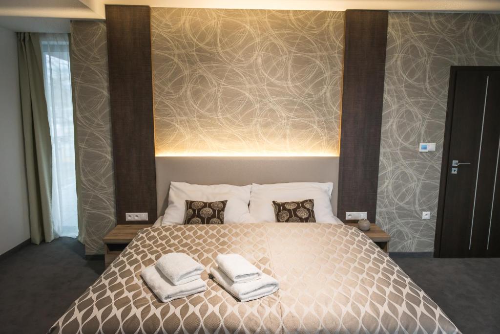 Posteľ alebo postele v izbe v ubytovaní Guest House Frizzante