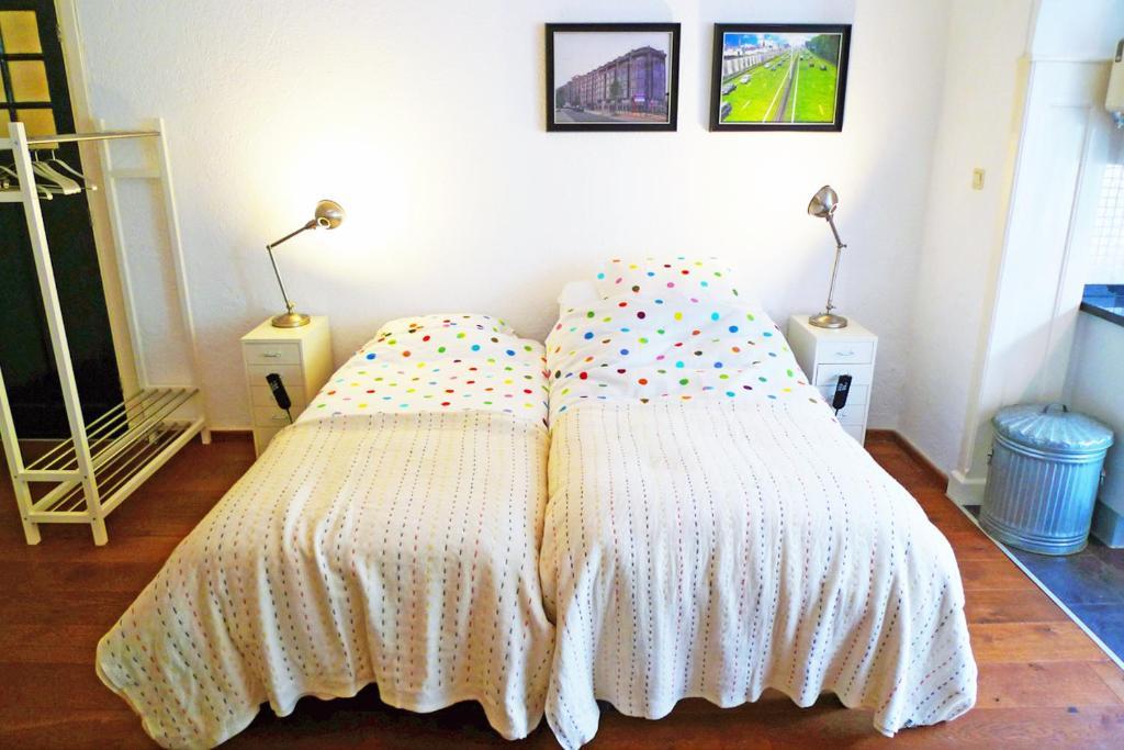 Een bed of bedden in een kamer bij Bed & Breakfast Walenburg