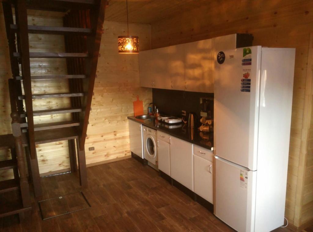 Кухня или мини-кухня в Halaktyrsky Dvor