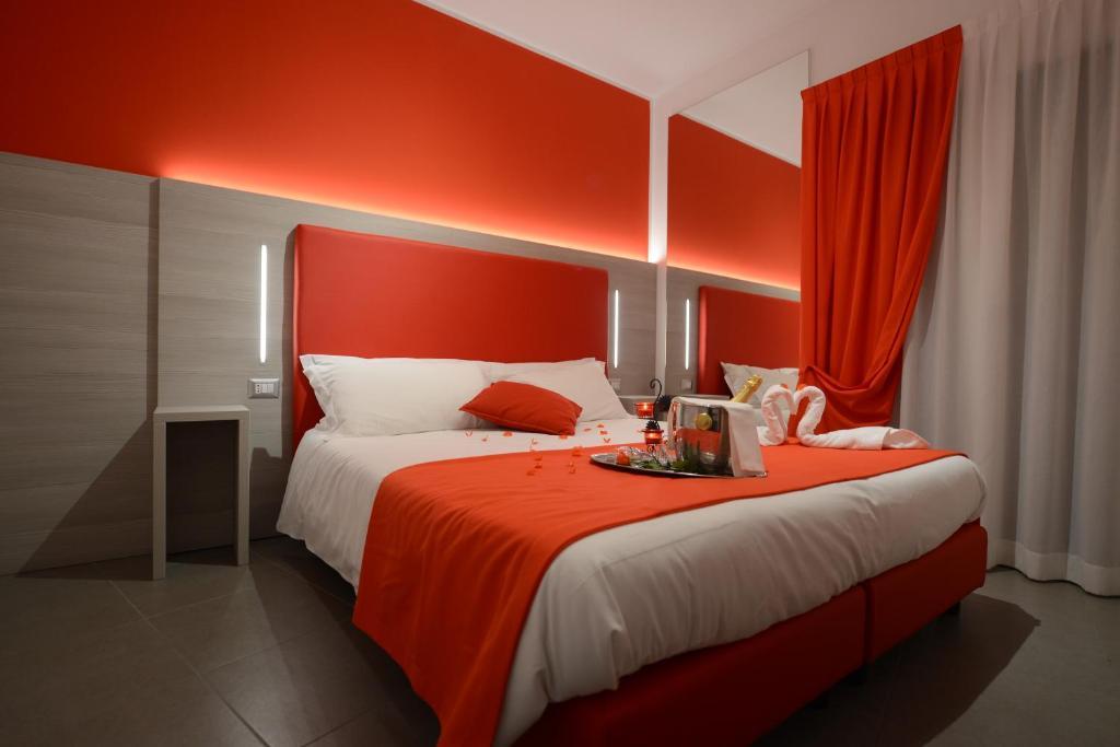 Letto o letti in una camera di Hotel Nuova Orchidea