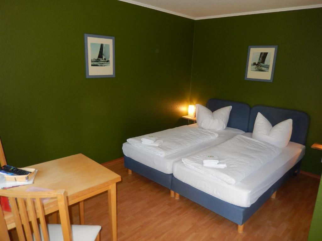 Кровать или кровати в номере Grenzmotel