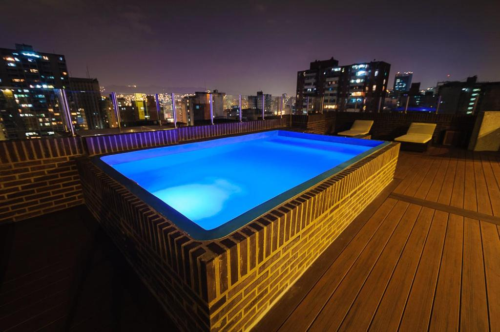 The swimming pool at or near Hotel Alex Caracas
