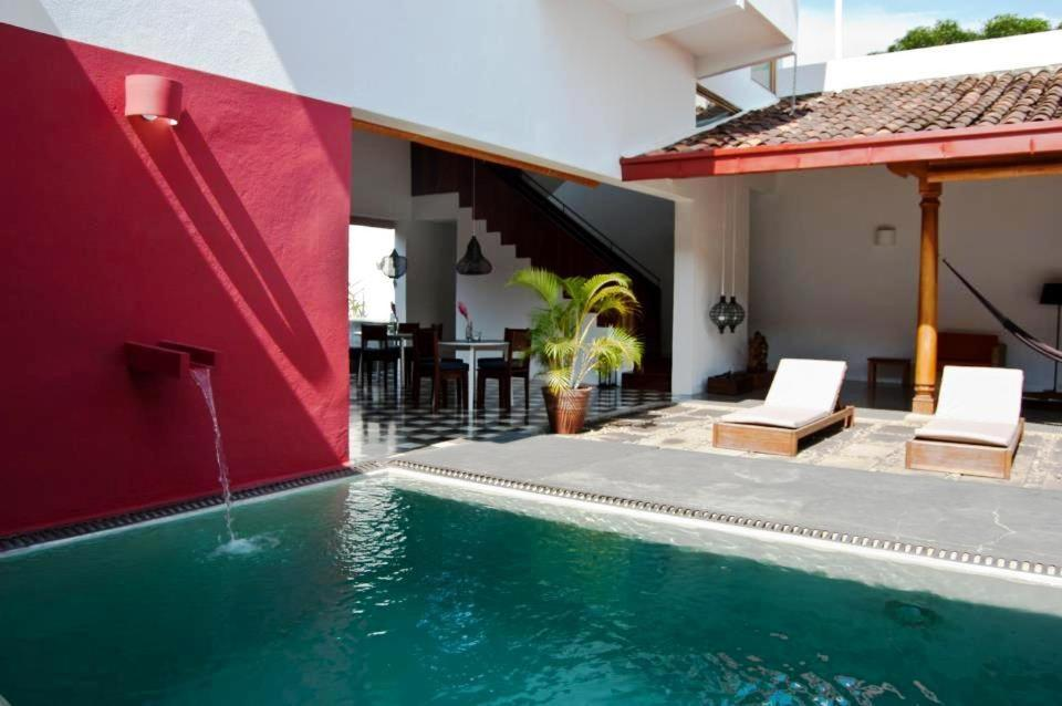 The swimming pool at or near Los Patios Hotel Granada