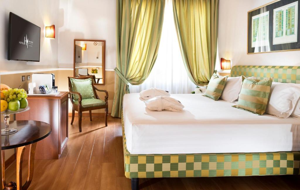 Letto o letti in una camera di Hotel Milton Roma