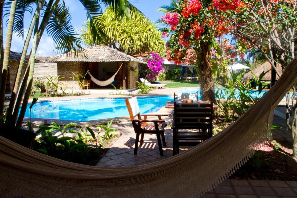 The swimming pool at or close to Pousada Berro do Jeguy