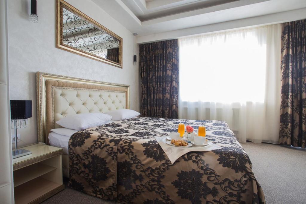 Кровать или кровати в номере Hotel RING