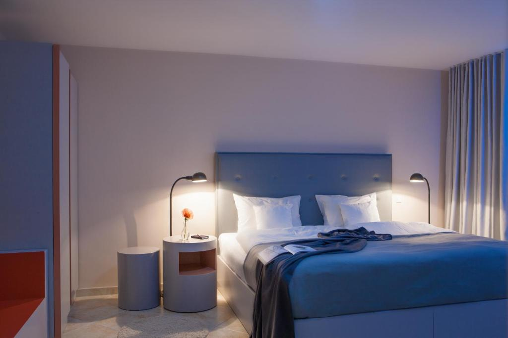 A bed or beds in a room at The Grey Design Hotel
