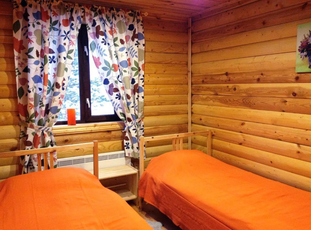 Кровать или кровати в номере Guest House V Verhnetulomskom