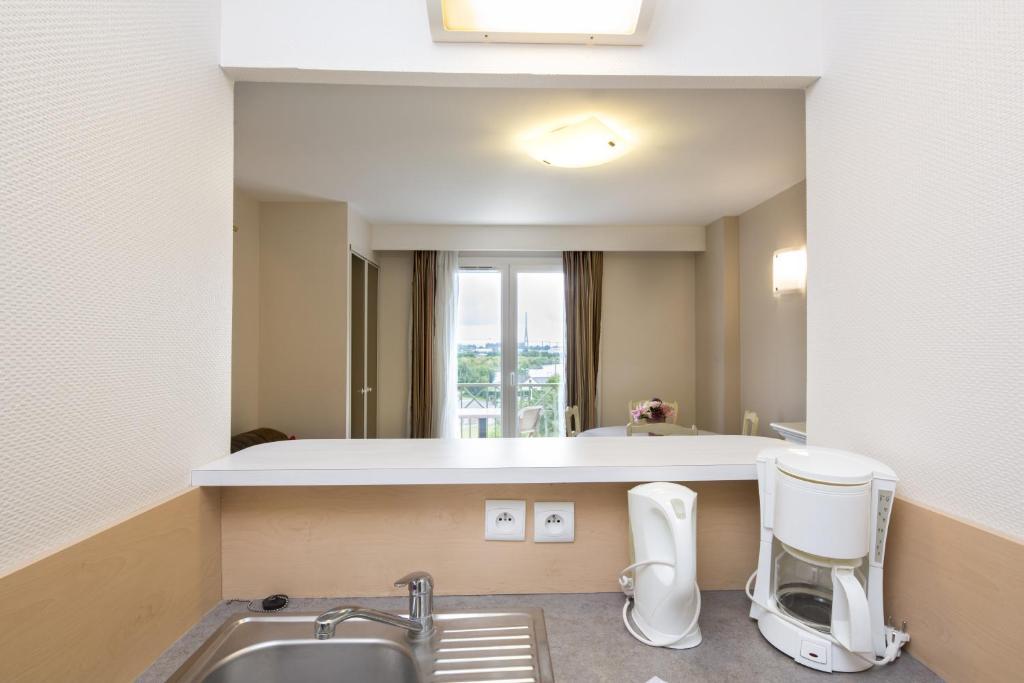 A bathroom at Tulip Inn Honfleur Residence