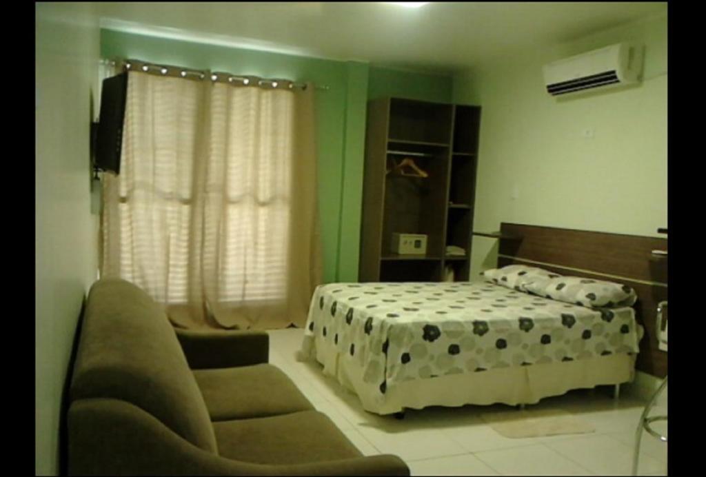 Cama o camas de una habitación en Ajuricaba Suites 1
