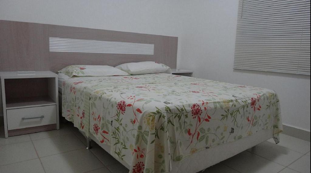 Cama o camas de una habitación en Ajuricaba Suítes 5
