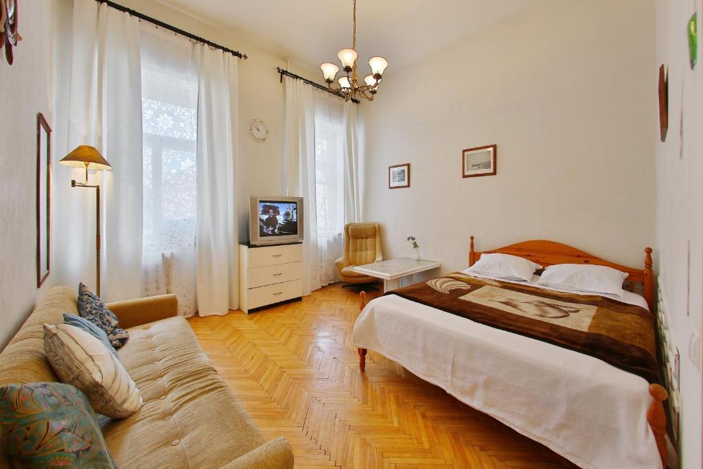 Кровать или кровати в номере Квартира у Мариинского театра