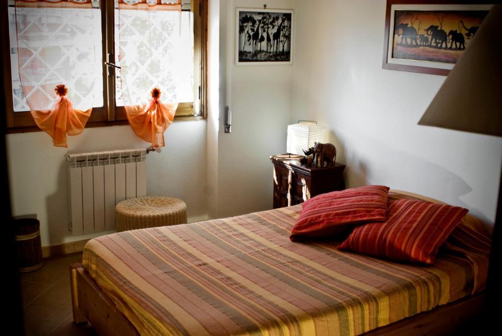 Letto o letti in una camera di B&B Agliarvali