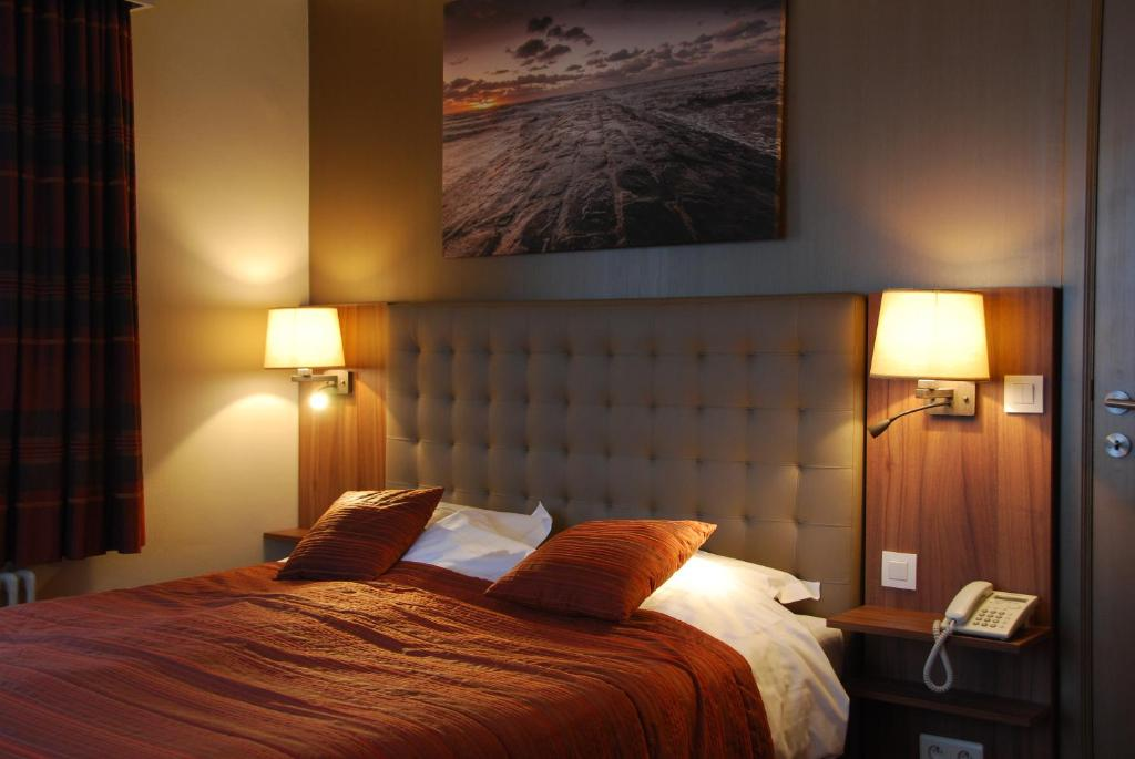 Un ou plusieurs lits dans un hébergement de l'établissement Hotel Rubens