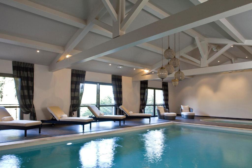 The swimming pool at or near Le Vallon de Valrugues & Spa
